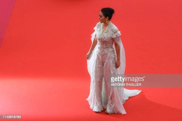 Chinese actress Gong Li poses as she arrives for the screening of the film The Dead Don't Die during the 72nd edition of the Cannes Film Festival in...