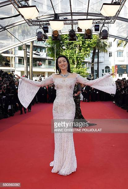 Chinese actress Gong Li poses as she arrives on May 11 2016 for the opening ceremony of the 69th Cannes Film Festival in Cannes southern France / AFP...