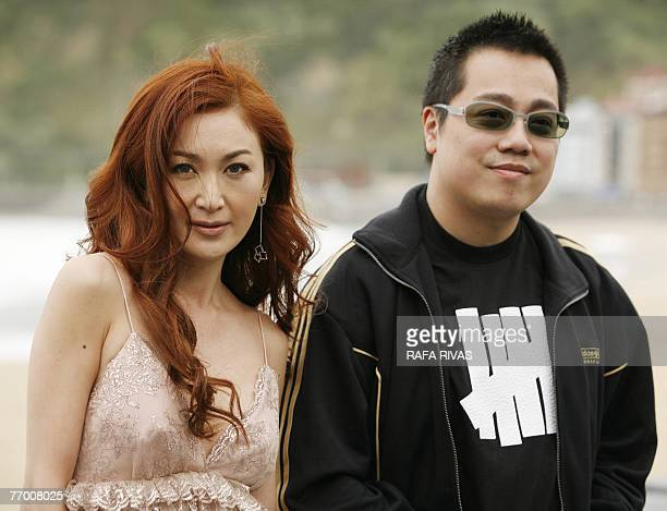 Chinese actress Irene Wan and Chinese director Pang HoCheung pose for photographers after the screening of the film 'Exodus' 25 September 2007 during...