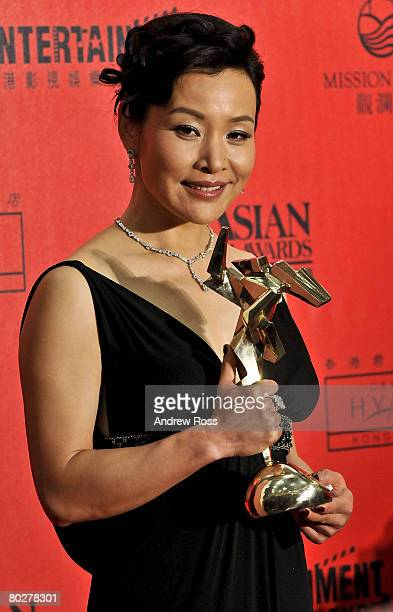 Chinese actress Joan Chen wins Best Supporting Actress for The Sun Also Rises at the Asian Film Awards 2008 in Hong Kong China