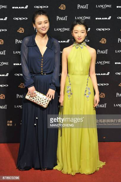 Chinese actress Ma Sichun and Chinese actress Zhou Dongyu arrive on the red carpet to attend Taiwan's 54th Golden Horse film awards dubbed the...