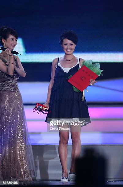 Chinese actress Ma Yili, winner of Best Actress reacts during the Awards and Closing Ceremony of the 9th Changchun Film Festival on July 6, 2008 in...