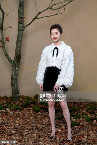 Chinese actress Maggie Jiang poses for a photocall before the Chanel's 2018/2019 fall/winter collection fashion show on March 6 2018 in Paris / AFP...