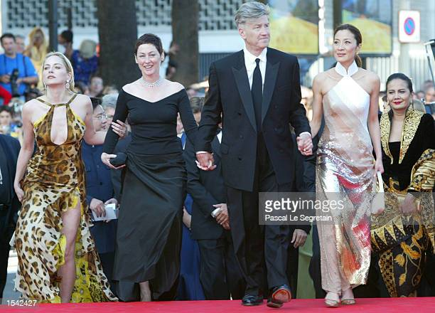 Chinese actress Michelle Yeoh director David Lynch his wife Mary and American actress Sharon Stone arrive for the opening ceremony at the 55th...