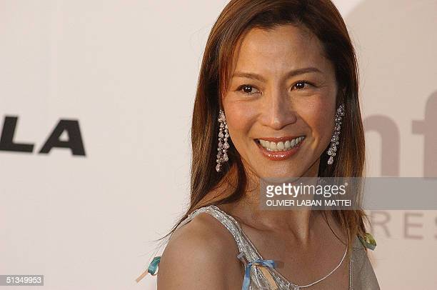 Chinese actress Michelle Yeoh poses for photographers as she arrives at the amFar benefit party in Mougins near Cannes 23 May 2002 AFP PHOTO OLIVIER...