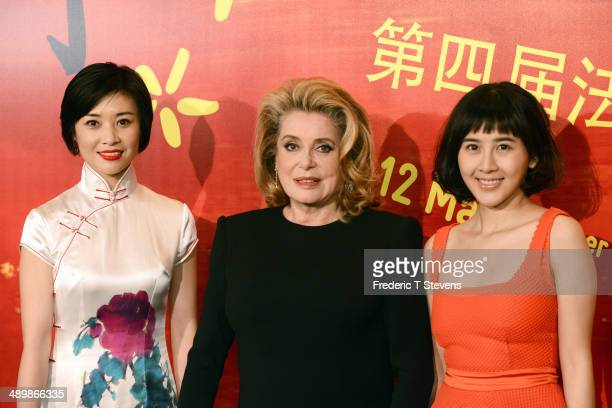 Chinese actress Xia Zi Tong and french actress Catherine Deneuve attend a photocall for the opening of the 4th Paris Chinese Film Festival at Cinema...