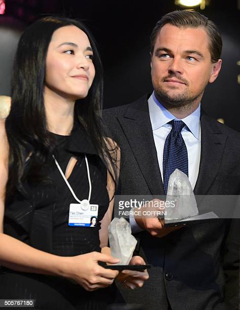 Chinese actress Yao Chen poses with US actor Leonardo DiCaprio after they were awarded during the 22nd Annual Crystal Awards at the opening of the...