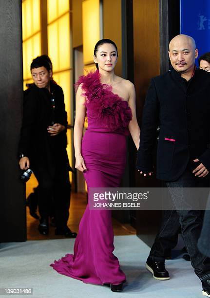 """Chinese actress Zhang Yuqi arrives with Chinese director Wang Quan'an for a press conference to present the film """"White Deer Plain"""" at the Berlinale..."""
