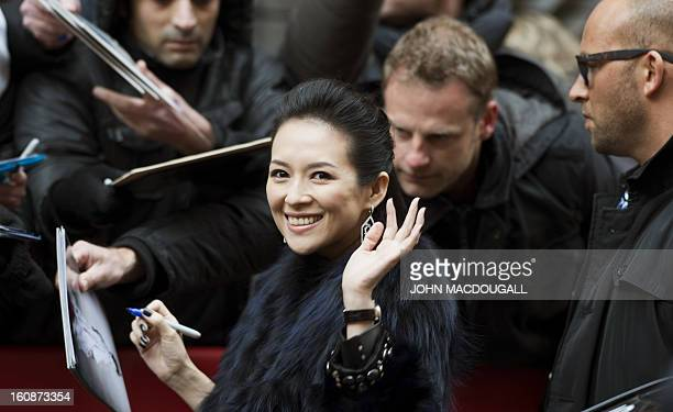 Chinese actress Zhang Ziyi gives autographs to her fans as she arrives for a photocall and a press conference for the film Yi dai zong shi in Berlin...