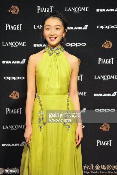 Chinese actress Zhou Dongyu arrives on the red carpet to attend Taiwan's 54th Golden Horse film awards dubbed the Chinese 'Oscars' in Taipei on...