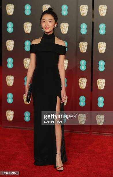 Chinese actress Zhou Dongyu poses on the red carpet upon arrival at the BAFTA British Academy Film Awards at the Royal Albert Hall in London on...
