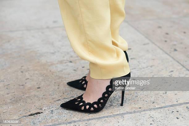 Chinese actress Zhu Zhu wears Stella McCartney trousers vintage shoes on day 7 of Paris Fashion Week Spring/Summer 2014 Paris September 30 2013 in...