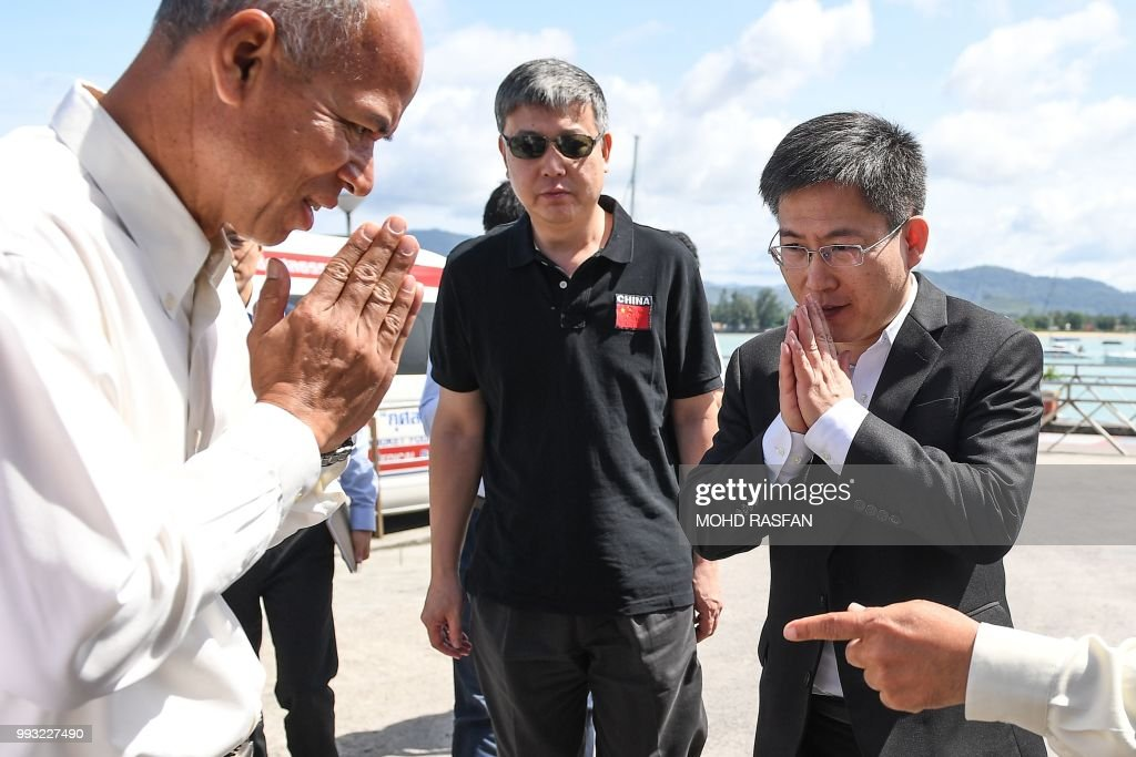 Chinese ambassador to Thailand, Lyu Jian (R) arrives in Chalong pier in Phuket on July 7, 2018 as rescue operations continue for missing tourists following a boat accident on July 5. - Thai rescuers pulled 37 bodies from waters off the coast of the holiday island of Phuket on July 6 after a tourist boat went down in heavy seas with dozens of Chinese passengers on board.
