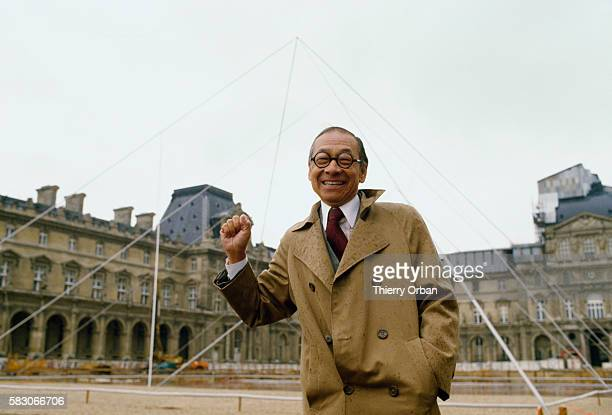 Chinese American Architect Ieoh Ming Pei stands next to a full size simulation of the his Louvre Pyramid during a press conference in Paris