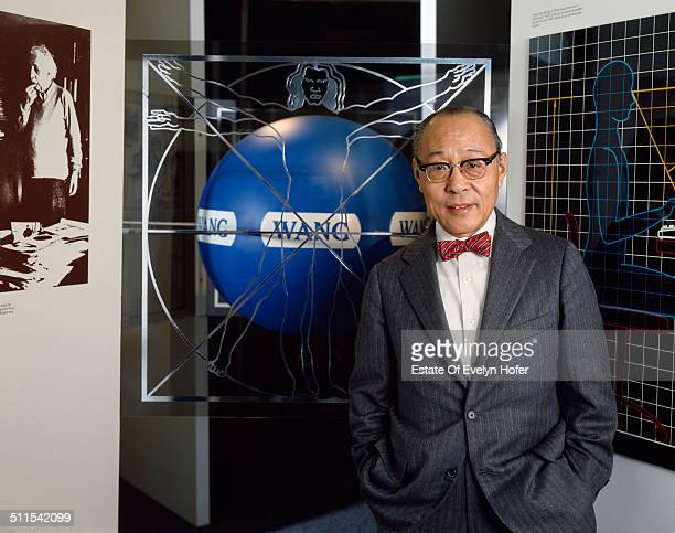 Chinese American inventor and computer engineer Dr An Wang cofounder of Wang Laboratories with a photo of Albert Einstein New York 1982