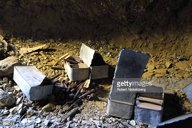 Chinese ammunition sits inside one of a caves used by Al Qaeda to store ammunition December 18 2001 near the destroyed training camp in the Milawa...