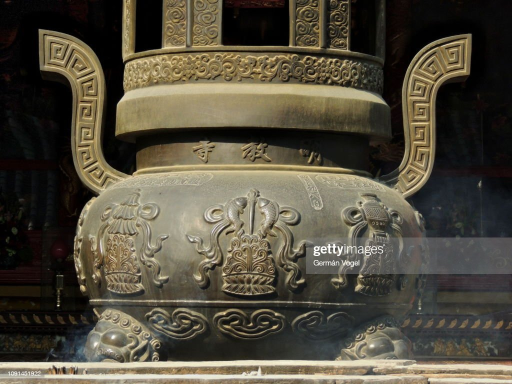 Chinese And Buddhist Art And Symbols On Bronze Incense Burner High Res Stock Photo Getty Images