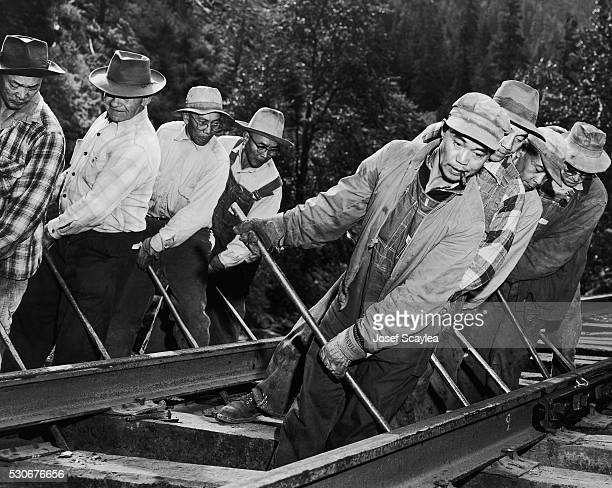 Chinese and Filipino workers lay track for the Burlington Railroad at Stevens Pass