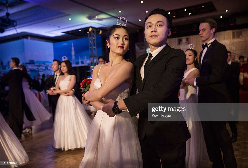 Chinese and foreign debutantes dance during the Vienna Ball at the Kempinski Hotel on March 19, 2016 in Beijing, China. The ball, which is an event organized by the luxury Kempinski Hotel chain and the City of Vienna, brings together both Chinese and foreign members of the capital's elite class. Despite a slowing economy, private wealth has soared in China after decades of rapid growth. A record number of high net worth individuals and families has fuelled a market for luxury goods, services, and events catering to China's burgeoning elite class.