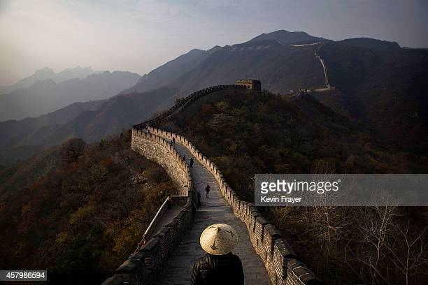 Chinese and foreign toursits walk on a section of the Great Wall of China on October 28 2014 in Mutianyu near Beijing China
