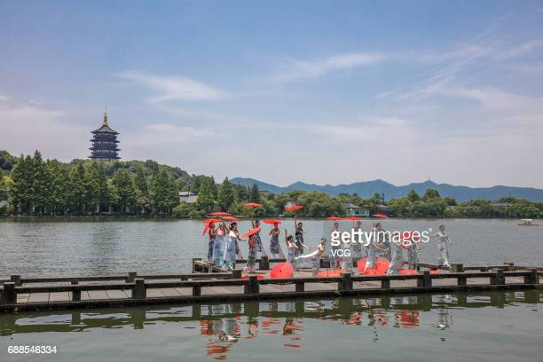 Chinese and foreign women dressed in cheongsam pose at West Lake during Hangzhou Global Cheongsam Day on May 26 2017 in Hangzhou Zhejiang Province of...