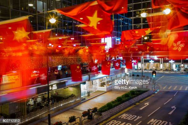 Chinese and Hong Kong flags are seen ahead of Chinese President Xi Jinping's arrival in Hong Kong for the 20th anniversary of the handover from...