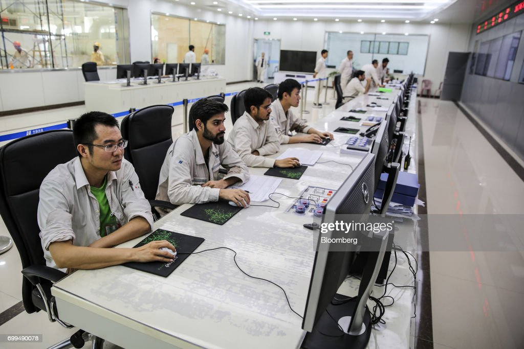 Chinese and Pakistani engineers work in a control room at the Sahiwal coal power plant owned by China`s stateowned Huaneng Shandong Rui Group in...