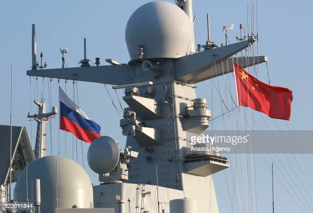 Chinese and Russian flag is seen on board of China's missile destroyer Hefei arrives at St Petersburg to take part in a ship parade marking Russian...
