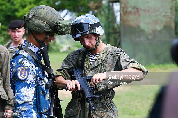Chinese and Russian marines take part in the 400meter seacrossing and landing training as a par of the ChinaRussia naval drill Joint Sea2016 on...