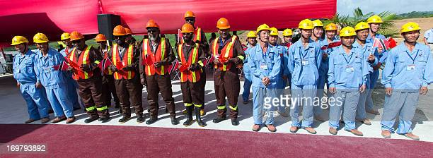 Chinese and Trinidadian workers wait for the arrival of Chinese President Xi Jinping at the site of the Couva Children´s Hospital in Port-of-Spain,...