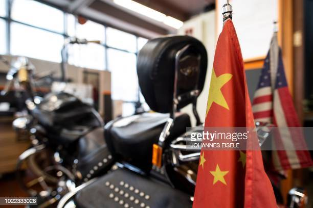 Chinese and US flags are seen on a HarleyDavidson motorcycle in the maintenance room of a dealership in Shanghai on August 24 2018 From...