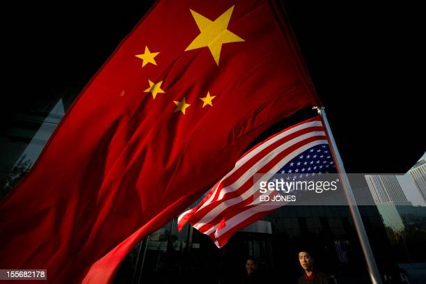 Chinese and US flags fly outside a hotel during a US presidential election results event organised by the US embassy in Beijing on November 7 2012...