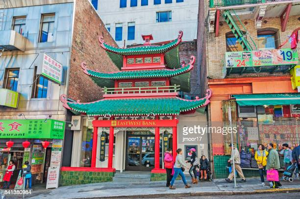 chinese architectural features and people in chinatown - san francisco chinatown stock photos and pictures