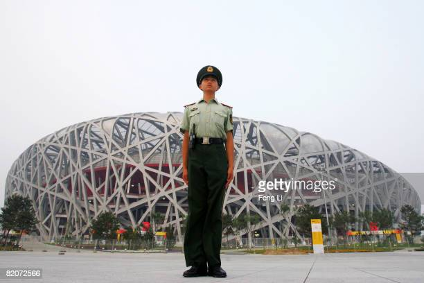 Chinese armed police guards during the explosive security check around the closed National Stadium known as Bird's Nest on July 26 2008 in Beijing...