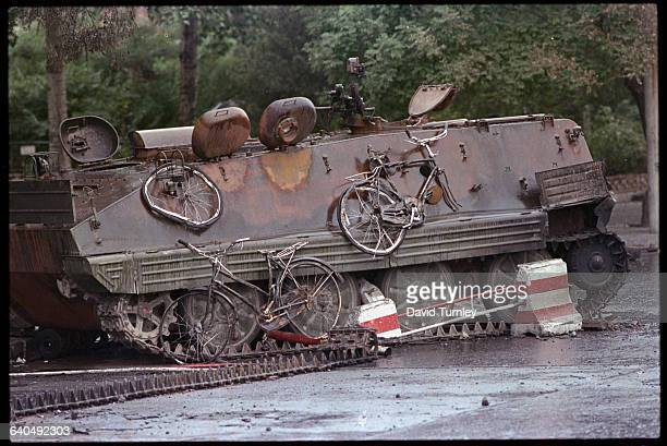 A Chinese armored personnel carrier with crushed bicycles stuck to its side sits in Tiananmen Square in the aftermath of the failed effort of some 2...