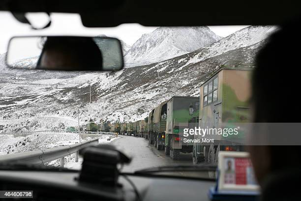 Chinese Army convoy seen through a windshield on March 21 2008 in Tibetan region China China has been grappling to quell unrest in several Tibetan...