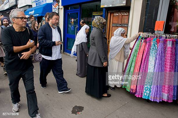 Chinese artist Ai Weiwei and Anish Kapoor walk with a following entourage of supporters and media through central London from the Royal Academy in...