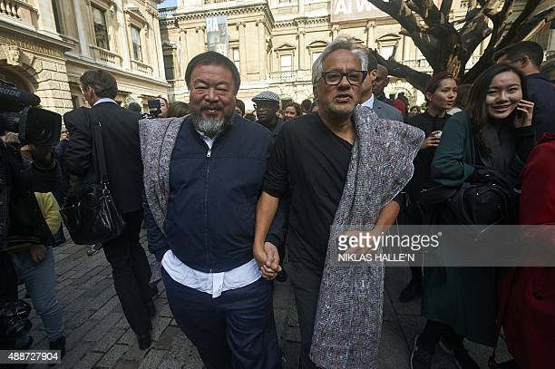Chinese artist Ai Weiwei and BritishIndian artist Anish Kapoor leave the Royal Academy of Arts in London on September 17 as they set off on a protest...