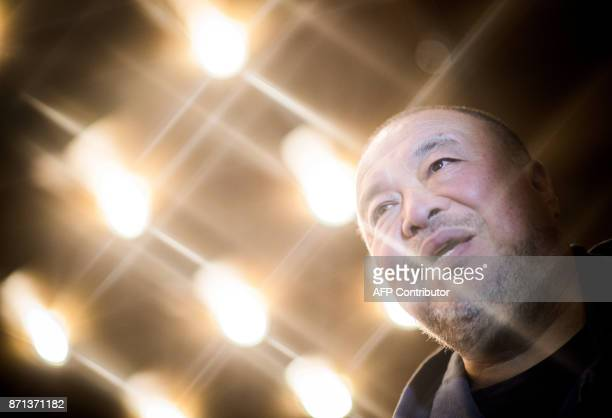 Chinese artist Ai Weiwei arrives to attend the screening of his documentary on the worldwide migrant crisis titled 'Human Flow' on November 7 2017 in...