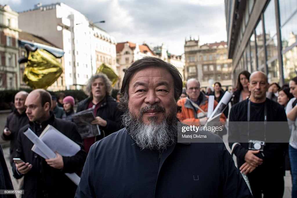 Chinese artist Ai Weiwei attends a gathering with media in front of the Trade Fair Palace run by the National Gallery on February 5, 2016 in Prague, Czech Republic. Ai Weiwei spoke to the media ahead of his 'Circle of Animals / Zodiac Heads' sculpture exhibition in front of the palace which runs from February 6 to August 31, 2016. Ai Weiwei wrapped his bronze heads with thermal blankets to protest against migrants situation in Europe. Ai Weiwei exhibits his work for the first time in the Czech Republic.