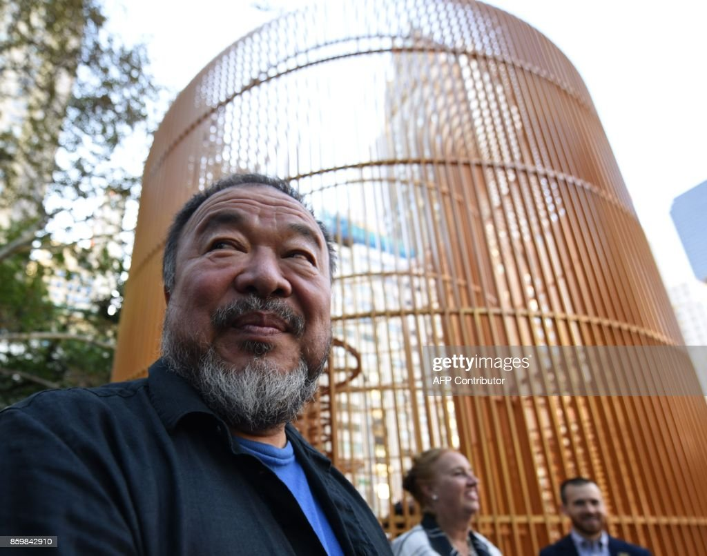 Chinese Artist Ai Weiwei attends his art installation exploring migration entitled 'Good Fences Make Good Neighbors' during a press conference at Doris C. Freedman Plaza in Central Park, New York City, on October 10, 2017 ahead of October 12's public opening of his multi-venue exhibition inspired by the international migration crisis. Spread across multiple New York boroughs, the multi-site project transforms metal wire security fences into artistic symbols by installing them in varying, site-specific forms at locations across the city. /