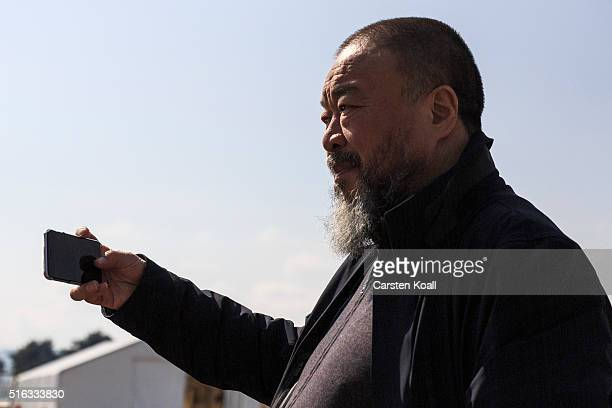 Chinese artist Ai Weiwei films with a smartphone in the Idomeni refugee camp at the Greek Macedonia border on March 18 2016 in Idomeni Greece Many of...