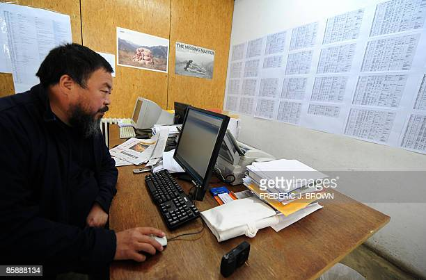 Chinese artist Ai Weiwei seated at his computer in his design studio Fake in an arts district on the outskirts of Beijing on April 10 2009 The son of...