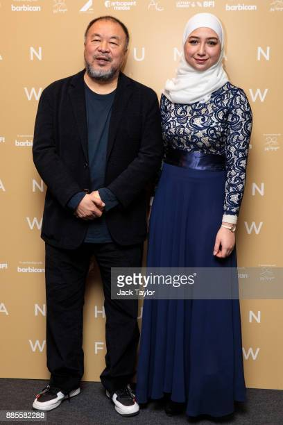 Chinese artist and director Ai Weiwei and Diana Legacy Award winner Maya Ghazal pose as they arrive for the Human Flow Premiere at Milton Court...