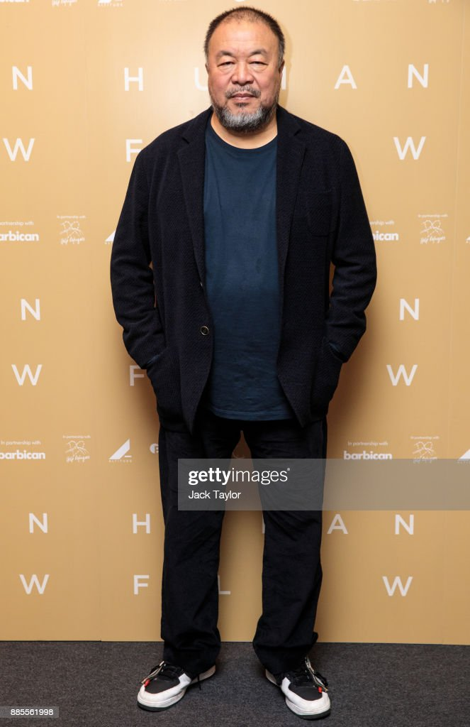 Chinese artist and director Ai Weiwei poses as he arrives for the Human Flow Premiere at Milton Court Concert Hall on December 4, 2017 in London, England.