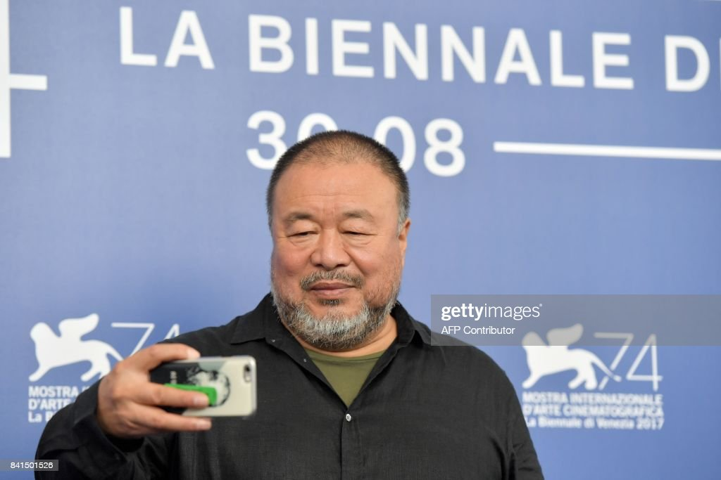 Chinese artist and producer Ai Weiwei attends the photocall of the movie 'Human Flow' presented in competition at the 74th Venice Film Festival on September 1, 2017 at Venice Lido. / AFP PHOTO / Tiziana FABI