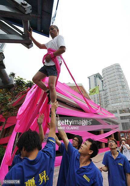 Chinese artist Li Wei performs outside a shop in Hong Kong on May 27 2010 Li Wei has performed all over the world to communicate his artistic message...