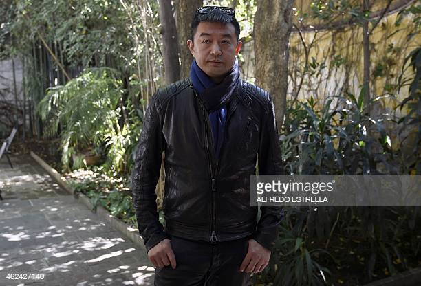 Chinese artist Liu Bolin gestures during an interview at the Fundacion Pedro Meyer in Mexico City on January 28 2015 AFP PHOTO /ALFREDO ESTRELLA