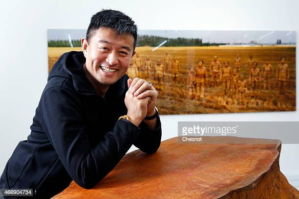 Chinese artist Liu Bolin poses at the galerie ParisBeijing on March 19 2015 in Paris France Liu Bolin is Internationally known and recognized artist...