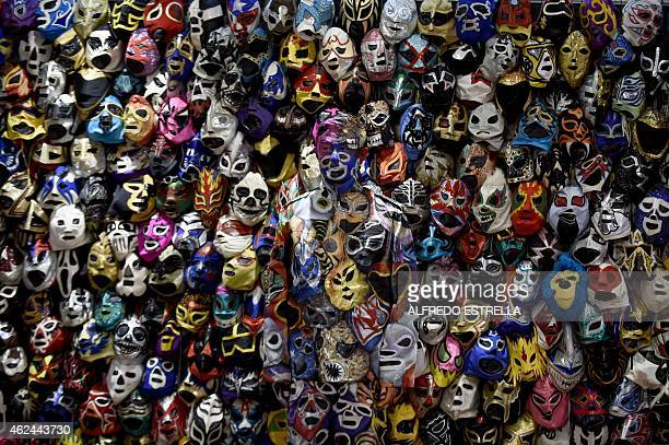 Chinese artist Liu Bolin stands during a performance with masks in the lobby of the Presidente Intercontinental Hotel in Mexico City on January 28...